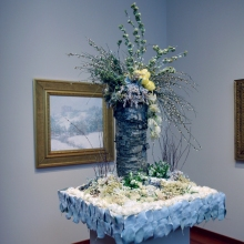 Willard Leroy Metcalf, Winter's Festival - painting & floral arrangement
