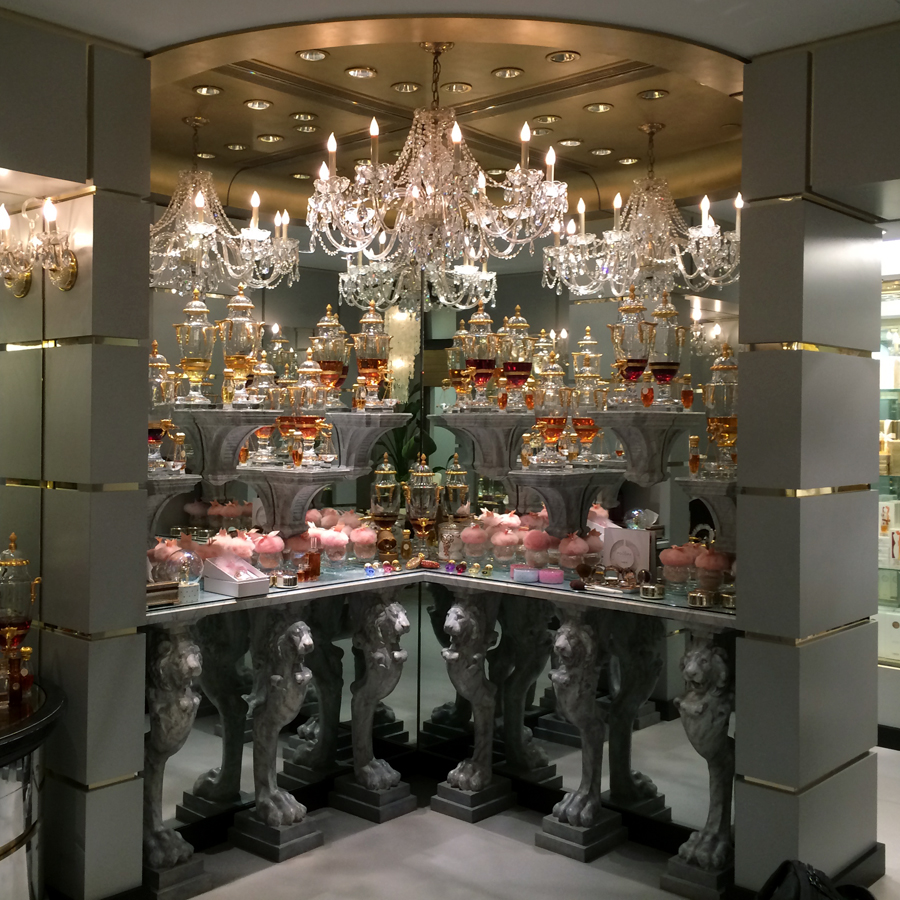 Along One Wall Are A Series Of Curio Cabinets Filled With More Of The  Travel Sprays, Unusual Perfume Bottles And A Scale Model Of The Baccarat  Crystal Urn ...